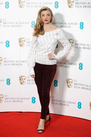Natalie Dormer paired her blouse with burgundy velvet skinnies.