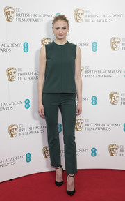 Sophie Turner styled her separates with classic black ankle-strap pumps by Jimmy Choo.