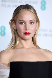 For her beauty look, Jennifer Lawrence went for a bold red lip teamed with neutral eyeshadow.