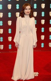 Isabelle Huppert went classic in a long-sleeve, high-neck ecru gown by Chloé at the 2017 BAFTAs.