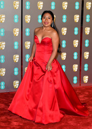 Yalitza Aparicio was a vision in a strapless red ballgown by Alberta Ferretti Limited Edition at the EE British Academy Film Awards.