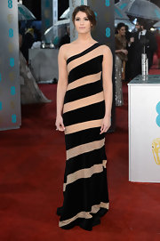Never one for the ordinary, Gemma Arterton loves to make bold fashion statements on the red carpet. For the BAFTAs, she chose a simple yet striking diagonally striped design featuring large black and nude panels. Simply gorgeous.