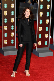 Ruth Wilson styled her suit with a pair of pearl T-strap sandals by Paula Cademartori.