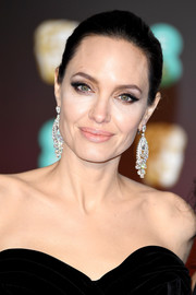 Angelina Jolie accessorized with a pair of diamond chandelier earrings by Graff for an ultra-glam finish.