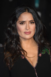 Salma Hayek stuck to her usual center-parted waves when she attended the EE British Academy Film Awards.