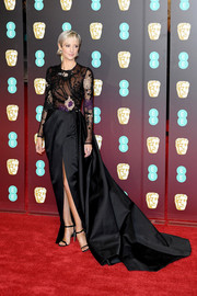 Andrea Riseborough went for simple styling with a pair of black slim-strap sandals by Jimmy Choo.
