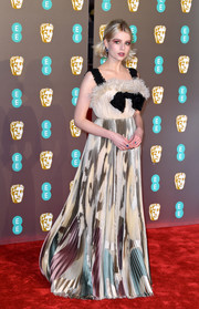 Lucy Boynton chose a Dior Couture gown with a furry neckline and a printed skirt for the EE British Academy Film Awards.