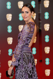 Louise Roe arrived for the 2017 BAFTAs carrying a stylish metallic tube clutch by Jimmy Choo.