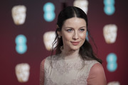 Caitriona Balfe went for a demure half-up hairstyle when she attended the 2017 BAFTAs.