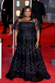 Octavia Spencer looked regal in a Sachin & Babi beaded gown with a sheer yoke and flutter sleeves at the EE British Academy Film Awards.
