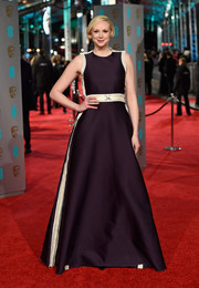 Gwendoline Christie attended he BAFTAs wearing a sleeveless aubergine and white gown.