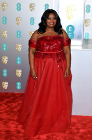 Octavia Spencer looked lovely in a red Sachin & Babi gown with a sequined bodice and an illusion neckline at the EE British Academy Film Awards.