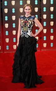 Emily Blunt worked an Alexander McQueen gown with an intricately embroidered bodice and a ruffled skirt at the 2017 BAFTAs.