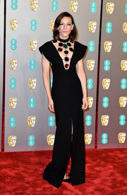 Cate Blanchett wowed in a black Christopher Kane gown with colorful gemstone embellishments at the EE British Academy Film Awards.