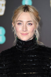 Saoirse Ronan styled her hair into a messy center-parted updo for the EE British Academy Film Awards.
