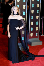 Natalie Dormer went for goth glamour in a black Alberta Ferretti off-the-shoulder gown with a long, sheer train and choker detail at the EE British Academy Film Awards.