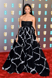 Thandie Newton dolled up in a strapless Valentino gown with a voluminous ruffled skirt for the EE British Academy Film Awards.