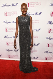 Ajak Deng looked fierce in a fully sequined column dress by Kaufmanfranco during the Blossom Ball.