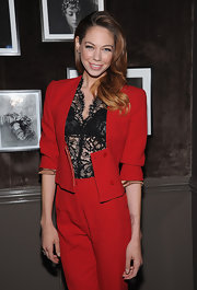 Analeigh Tipton attended a private dinner in NYC wearing a pair of tri-link diamond stud earrings.
