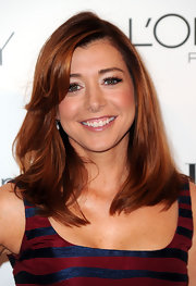 Alyson is one ravishing red head! Her side parted straight cut is the perfect length for her face shape.