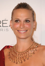 Molly Sims complemented her sleek bun with a beaded statement necklace.