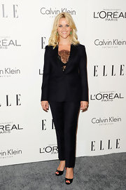 Reese Witherspoon stepped out for the Women in Hollywood Tribute wearing a sophisticated black suit.