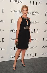 Katherine Heigl added a hint of shine to her embellished black dress with a gold and black studded clutch.