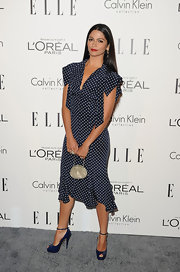 Camila Alves complemented her '40s vibe with a petite silver bag with a delicate strap.