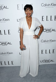 Meagan Good looked sexy and stylish in a white Marchesa jumpsuit with a revealing neckline during the Elle Women in Hollywood celebration.