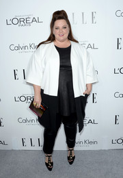 Melissa McCarthy looked modern and stylish at the Elle Women in Hollywood celebration in a black-and-white coat by Calvin Klein teamed with leather skinnies.