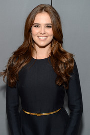 Zoey Deutch sported a gold skinny belt for a touch of shine to her dark dress at the Elle Women in Hollywood celebration.