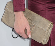 Eva Amurri carried a very stylish beige snakeskin clutch by Longchamp when she attended the Elle Women in Hollywood celebration.