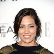 Michaela Conlin's tousled updo and dewy cheeks