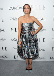 Marion Cotillard showed her devotion to Dior with this metallic silver strapless dress when she attended the Elle Women in Hollywood celebration.