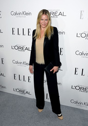 Chelsea Handler opted for a black suit teamed with a nude blouse when she attended the Elle Women in Hollywood celebration.