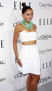 Kat Graham looked like a character from a sci-fi movie in this pleated white skirt, strapless crop-top, and statement necklace combo at the Elle Women in Hollywood celebration.