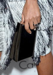 Naomie Harris accessorized with a simple yet elegant black box clutch at the Elle Women in Hollywood celebration.