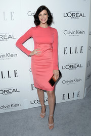 Jessica Pare complemented her sweet dress with a pair of sexy nude evening sandals.