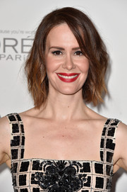 Sarah Paulson's bold red lipstick provided a blast of color to her monochrome outfit.