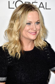 Amy Poehler topped off her look with boho center-parted waves during the Elle Women in Hollywood event.