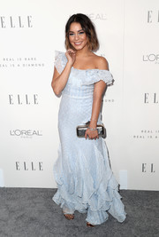 Vanessa Hudgens paired her cute dress with a metallic clutch by Jimmy Choo.