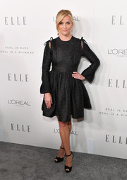 Reese Witherspoon completed her all-black look with a pair of Christian Louboutin peep-toe heels.