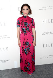 Zoe Lister Jones brightened up the gray carpet with this fuchsia McQ by Alexander McQueen floral gown during Elle's Women in Hollywood celebration.