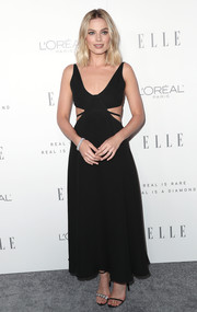 Margot Robbie teamed her dress with the celeb-favorite Calvin Klein mismatched crystal heels.