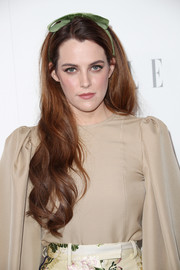 Riley Keough looked perfectly sweet with her flowing waves, complete with a green headband, during Elle's Women in Hollywood celebration.