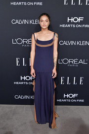 Sasha Lane showed her elegant side in a navy Loewe slip gown with orange accents at the 2018 Elle Women in Hollywood celebration.