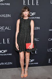 Caitriona Balfe added an extra pop of color with a red box clutch by Calvin Klein.
