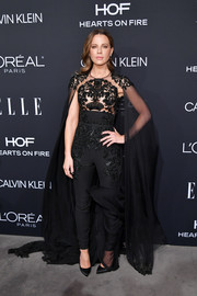 Kate Beckinsale made a dramatic entrance in a caped black jumpsuit by Zuhair Murad Couture at the 2018 Elle Women in Hollywood celebration.