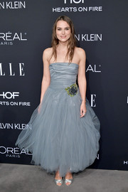 Keira Knightley paired her dress with silver peep-toes by Tabitha Simmons.