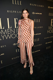 Lake Bell completed her outfit with nude sandals by Manolo Blahnik.